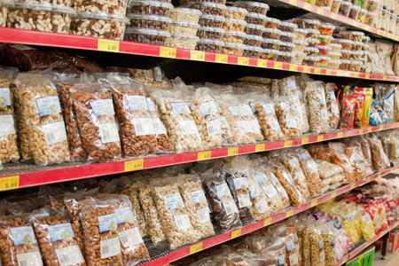 A selection of snack foods including nuts and biscuits at Malibu Fresh Essentials