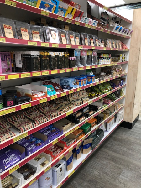 A selection of snack foods including nuts and biscuits at Malibu Fresh Essentials in Rockingham